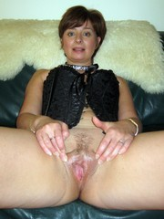 Beautiful lady with wet and dripping cunt