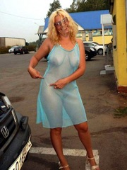 Luscious blonde mom dressed in a..