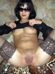 Mature slut in the black glasses