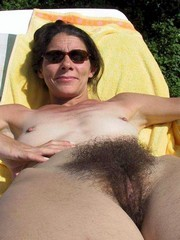 Mature women with glasses posing naked..