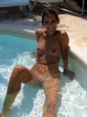 Naked milf in the pool