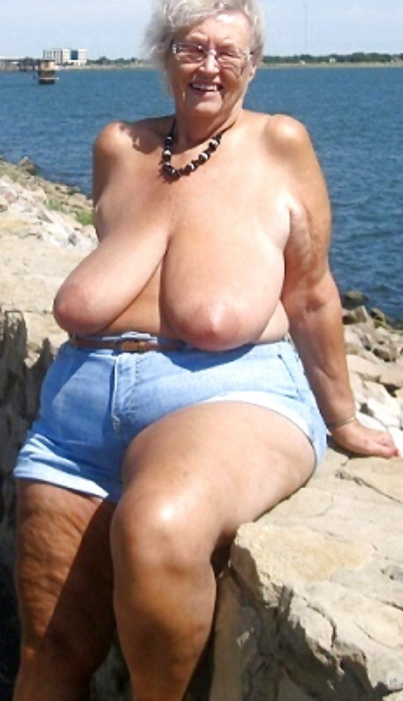 Old woman with wrinkled skin and huge saggy boobs ...