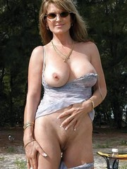 Your Busty mom posing naked