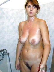 Shy middle-aged wife naked in the shower