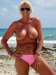 Naked mature women on the beach